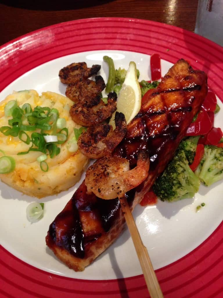 Gluten Free BBQ Salmon, Cheesy Mash, Seasoned Veg & a Cajun-Spiced King Prawn Skewer!