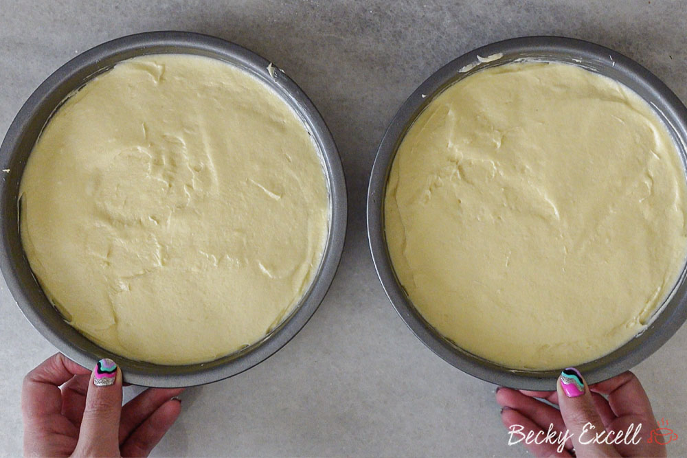 Gluten-free Victoria Sponge Cake Recipe: Divide the cake batter between two round baking tins.