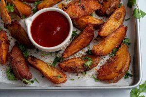 Spicy Baked Potato Wedges Recipe (vegan, low FODMAP)