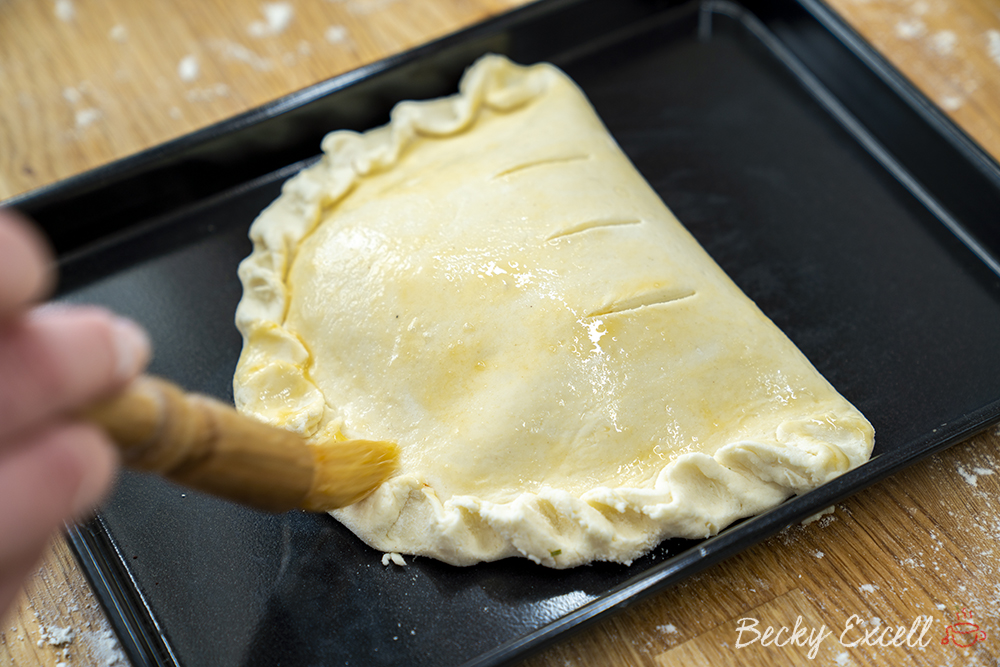 Brush the gluten free calzone with beaten egg to ensure it has a lovely colour once baked