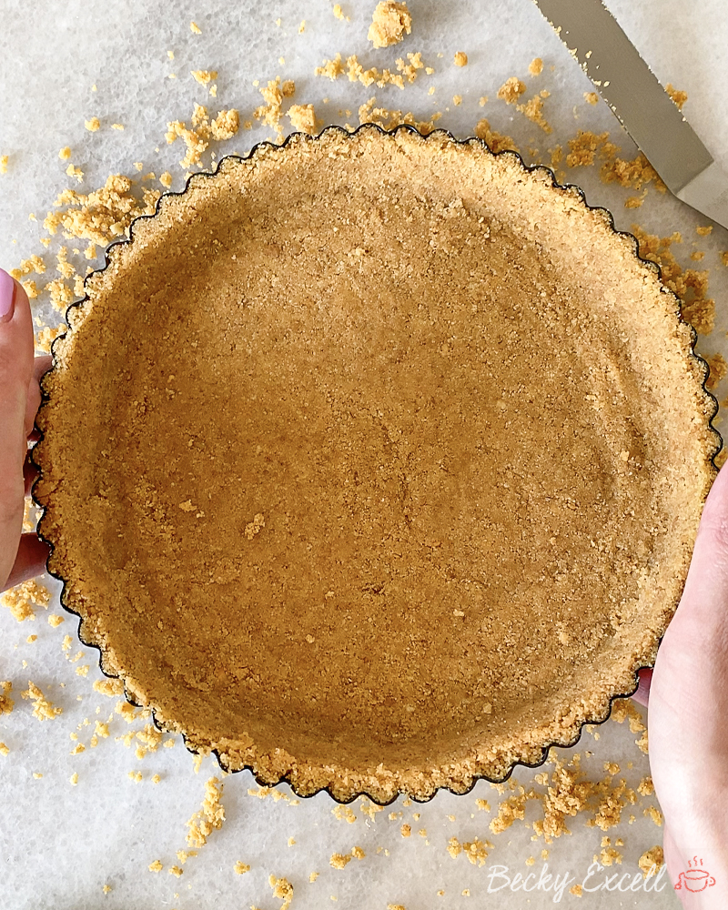 Gluten-free Chocolate Orange Toblerone Tart Recipe: Press your crushed biscuit mixture into your fluted tart tin